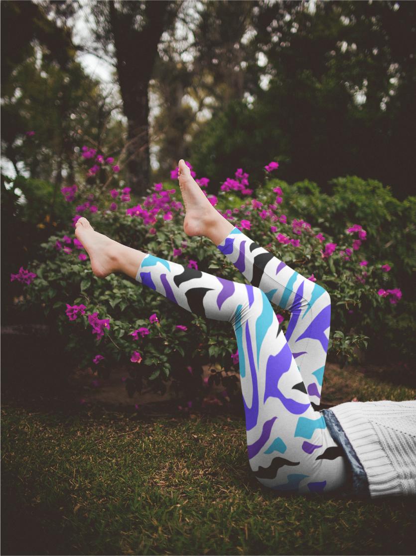 AwakeNAware.com-Awake-&-Aware-Woman-with-Legs-up-Wearing-Unicorn-Yoga-Leggings