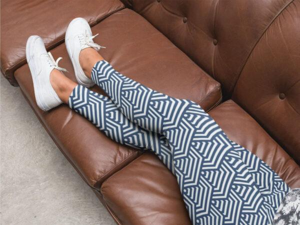 AwakeNAware.com-Awake-&-Aware---Lady-on-couch-wearing-Hexagonal-Patterend-Yoga-Leggings